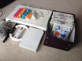 Nintendo Wii bundle, with Wii Fit board, 21 games, Steering Wheel, controllers and nunchucks