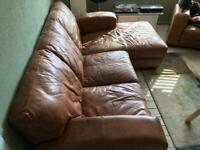 Leather sofa with leg extension