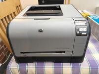 HP Colour Laserjet cp1515n printer and spare toner cartridges