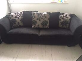 8ft Black Sofa with floral cushions. Unable to fit in new house as we have down sized.