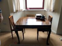 brown dining table and chairs