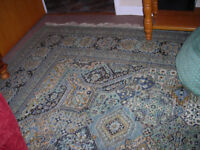 LARGE rug with fringe. Perfect condition. Green and blue pattern.