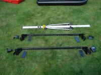 Halfords roof cycle carrier. Rarely used, carries most bikes and fits on standard roof bars.