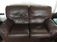 Brown leather 2 seater recliner.
