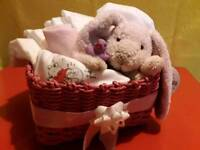 Nappy basket with soft toy