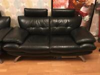 Black leather look sofa