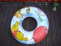 """Winnie the Pooh inflatable ring. Internal hole is 10"""", edge to edge size is 27"""". VGC. £4.50."""