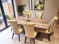 Beautiful marble dining table and leather chairs