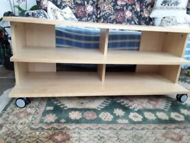 Wooden tv stand on wheels,
