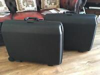 Pair of matching black Samsonite suitcases