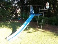 Free to good home, a garden swing and slide with basket ball hoop.