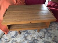 Space saving folding dining table with formica top.