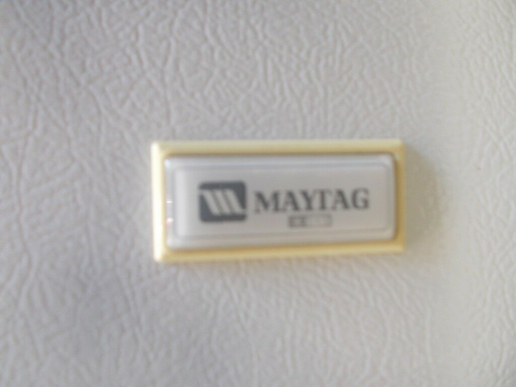 A LARGE MAYTAG FRIDGE FREEZER