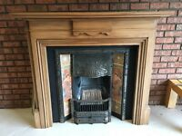 Fireplace with cast iron hearth and decorative tile inset