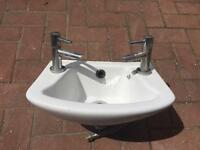 Small sink with taps