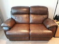 2 reclining 2 seater brown leather sofas. 1 electric 1 manual. Very good condition.
