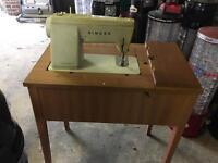 Fold away sewing machine table