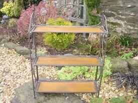 Metal framed shelf unit. Leaf and flower design.