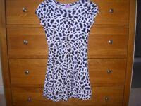 Girls Dress Black leopard print. Age 7-8 yrs. Height 128cm chest 54 cm