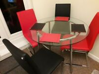 modern glass table and chairs good condition red and black