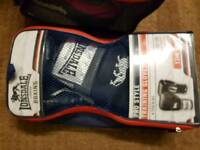 A punch bag with gives and Jab Pads