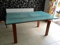 Stunning glass dining table with cherry wood legs