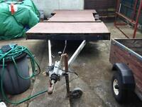 Flat bed twin axle trailer