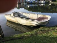 Flat bottom boat 18ft x 7 ft with 15 hp Yamaha engine. Needs cleaning and some repairs