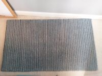 Stripy teal rug by M and S.