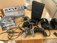 PlayStation 2 Superslim with lots of controllers and Games