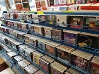 3,000 CDs for Sale. All Genres, in great retail condition with racks! Ideal for trader or bootsale