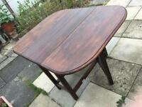 Quality solid drop leaf dining table in excellent condition