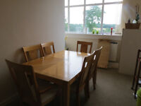 Family dining table with central extension and 8 chairs