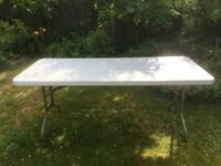 Two very solid trestle tables for sale