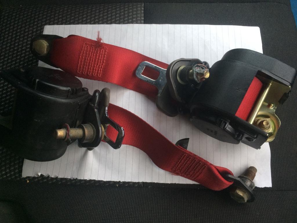 Classic Mini Cooper red seat belts.