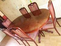 Large heavy solid wood Table and 6 chairs large