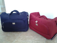 Liz Claiborne luggage/holdall. Matching pair, one red and one blue.