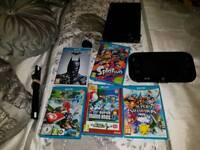 Nintendo Wii U 32GB black deluxe + six games and amiibo