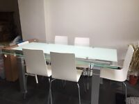 Fabulous glass dining room table and chairs