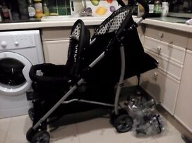 My Child Sienta Duo Tandem pram with rain cover in black and white in good condition