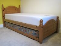 Single wooden bed complete with under bed and 2 mattresses