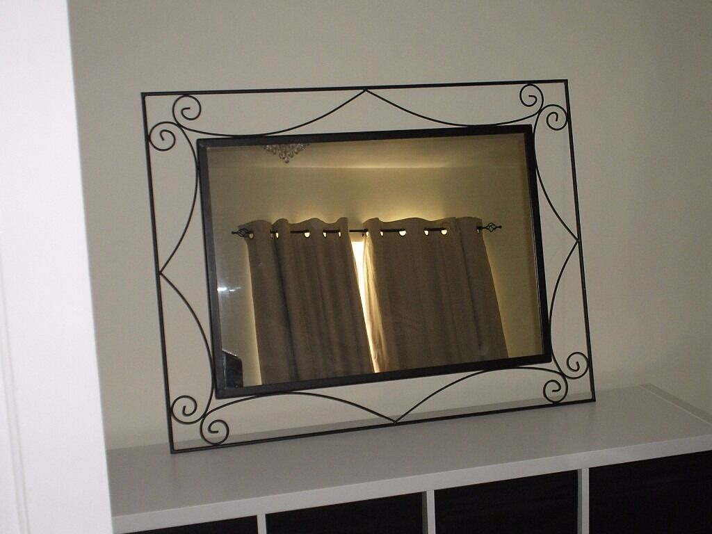 large ornate matt black metal framed mirror