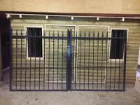 Pair of black wrought iron gates