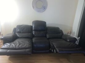 Dark brown leather reclining sofa and chair