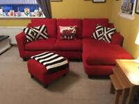 Red corner sofa and foot stool