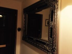French Ornate mirror with beautiful light bronze and black surround
