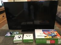 X Box One, 2 wireless controllers, 3 games, chat headset and 50 inch Toshiba TV