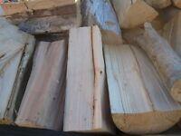 A load of seasoned firewood logs for sale