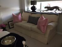 Three seater Laura Ashley sofa with matching footstool.