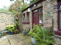 Spacious and charming 1-bedroom coachhouse to let